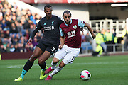 Burnley forward Jay Rodriguez (19) and Liverpool defender Joel Matip (32) during the Premier League match between Burnley and Liverpool at Turf Moor, Burnley, England on 31 August 2019.