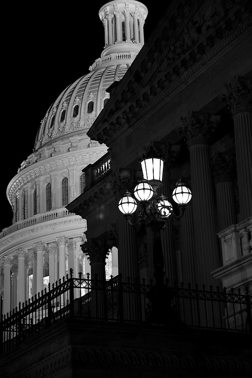 The U.S. Capitol in Washington, DC is illuminated brightly at night.