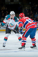 KELOWNA, CANADA -JANUARY 29: Ryan Olsen #27 of the Kelowna Rockets faces off against Carter Proft LW #15 of the Spokane Chiefs on January 29, 2014 at Prospera Place in Kelowna, British Columbia, Canada.   (Photo by Marissa Baecker/Getty Images)  *** Local Caption *** Ryan Olsen; Carter Proft;