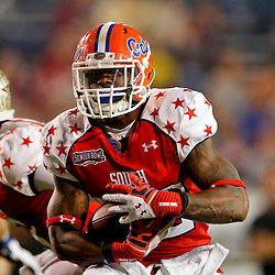 Jan 26, 2013; Mobile, AL, USA; Senior Bowl south squad running back Mike Gillislee of Florida (22) runs against the Senior Bowl north squad during the second half of the Senior Bowl at Ladd-Peebles Stadium. The South squad defeated the North squad 21-16. Mandatory Credit: Derick E. Hingle-USA TODAY Sports