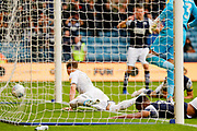 Leeds United defender Ezgjan Alioski (10) scores a goal to make the score 2-1 during the EFL Sky Bet Championship match between Millwall and Leeds United at The Den, London, England on 5 October 2019.