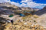 Backpacker under Bishop Pass, John Muir Wilderness, Sierra Nevada Mountains, California USA