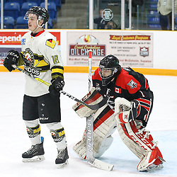 "TRENTON, ON  - MAY 5,  2017: Canadian Junior Hockey League, Central Canadian Jr. ""A"" Championship. The Dudley Hewitt Cup Game 7 between Georgetown Raiders and the Powassan Voodoos.    Brett Hahkala #18 of the Powassan Voodoos stands in front of Josh Astorino #1 of the Georgetown Raiders during the first period<br /> (Photo by Alex D'Addese / OJHL Images)"