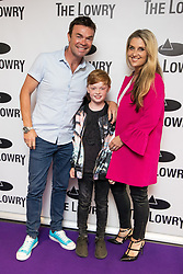 © Licensed to London News Pictures . 30/08/2017 . Salford , UK . Key 103 radio presenter Darren Proctor and his family . Purple carpet photos of celebrities, actors and invited guests arriving for the press night of the musical comedy , Addams Family , at the Lowry Theatre . Photo credit : Joel Goodman/LNP