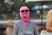 Women Wear Facekinis on the Beach in China