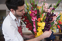 Florist works on flower arrangement