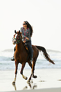 Israel, Caesarea, Horse riding on the beach of the Mediterranean sea