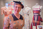 Julie Summers author of the book of the show with Victory dresses - Fashion on the Ration: 1940s Street Style – a new exhibition at the Imperial War Museum to mark the 70th anniversary of the end of the Second World War in 1945.  Divided into six sections:  Into Uniform looks at how Second World War Britain became a nation in uniform;  Functional Fashion explores how the demands of wartime life changed the way civilians dressed at work and at home;  Rationing and Make do and Mend will look at why clothes rationing was introduced in 1941, how the scheme worked and how it changed the shopping habits of the nation, including a bridesmaid's dress made from parachute material, a bracelet made from aircraft components, a child's coat made from a blanket and on display for the first time a bra and knickers set made from RAF silk maps for Countess Mountbatten;  Utility Clothing was introduced in 1941 to tackle unfairness in the rationing scheme and standardise production to help the war effort; Beauty as Duty examines the lengths to which many women went, to maintain their personal appearance – and the pressure they felt to do so; and Peace and a new look? which looks at how the end of the war impacted upon fashion, and considers the long-term impact, including a 'VE' print dress worn by the comedienne Jenny Hayes to celebrate the end of the war, and an example of the ubiquitous demob-suit, issued to men leaving the military services. The exhibition runs from 5 March – 31 August 2015