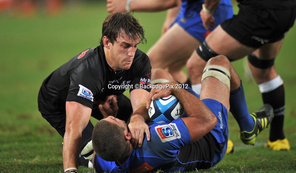Keegan Daniel of the Sharks tackling Matt Hodgson of the Western Force<br /> <br /> &copy; Sabelo Mngoma/BackpagePix