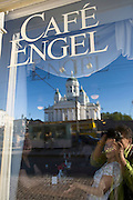 Café Engel, named after German architect Carl Ludwig Engel who designed this Senate Square; the lutheran Cathedral reflected in the window.