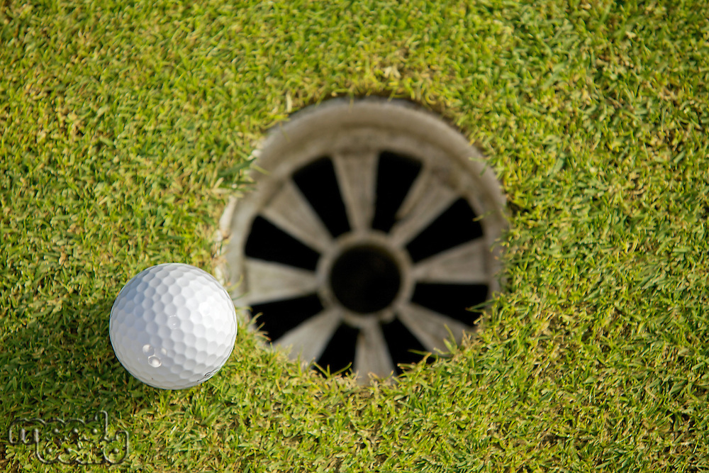 Close-up of golf ball near hole