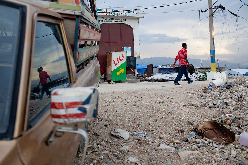 A man walks down the street on July 13, 2010 in the Fort National neighborhood in Port-au-Prince, Haiti.
