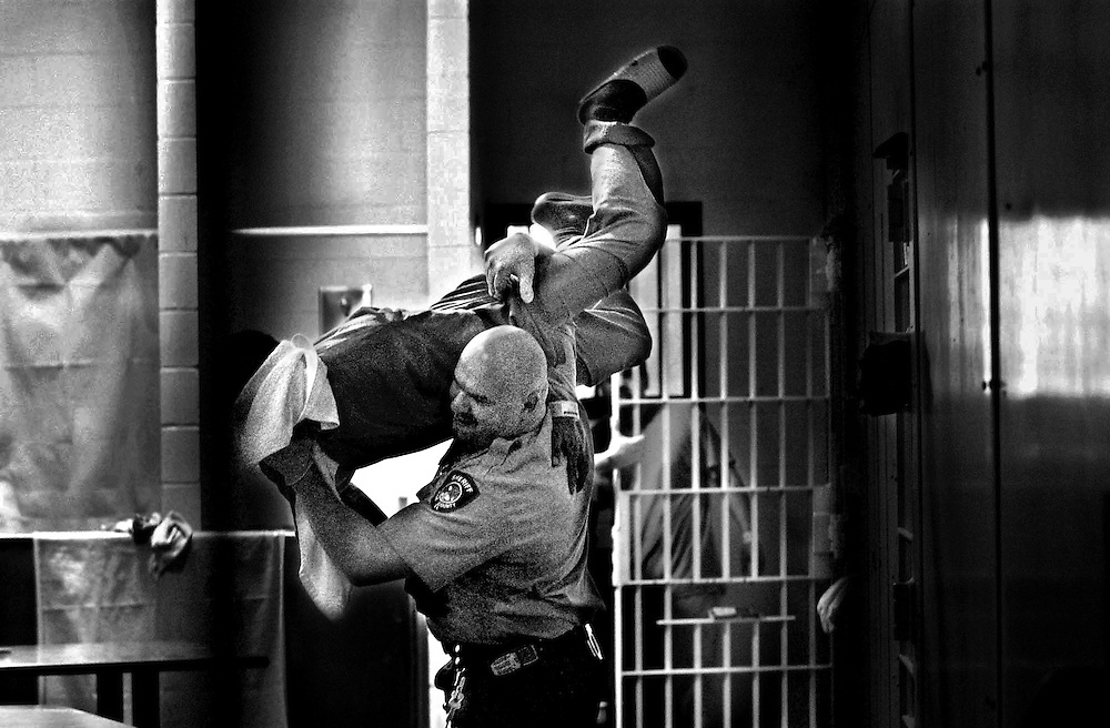 """Some inmates ask """"Weekday jailer, weekend wrestler"""" officer Don Lang to """"show them some moves"""" so he'll occasionally scoop someone up in a playful bodyslam type fashion."""