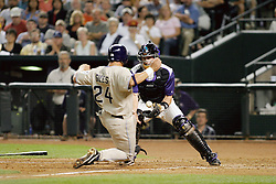 Phoenix,AZ - 04/24/04 Catcher Robbie Hammock of the Arizona Diamondbacks fails to hold on to the ball allowing Brian Giles to score the tying run in the eighth inning. The Padres went on to win 4-2. Ross Mason photo
