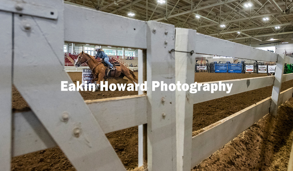 A woman compeats on the second day of qualifiers for the Grand Slam #4 All Bull Rodeo & Barrel Racing in McGough Arena at the WNC Agricultural Center in Fletcher, NC on June 1, 2018.