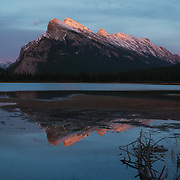 The last of dusk's pink light off the peaks of Mt. Rundle.