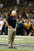 NEW ORLEANS, LA - NOVEMBER 11:  Head Coach Mike Smith of the Atlanta Falcons watches his team warm up before a game against the New Orleans Saints at Mercedes-Benz Superdome on November 11, 2012 in New Orleans, Louisiana.  The Saints defeated the Falcons 31-27.  (Photo by Wesley Hitt/Getty Images) *** Local Caption *** Mike Smith