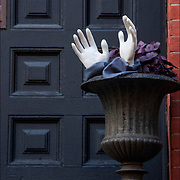 Halloween decoration of plastic white hands on side of door to brownstone in Greenwich Village, NYC.