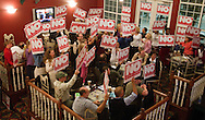People cheer as a local television station reports live from the Iowa For Freedom watch party held at Comfort Suites in Urbandale, Iowa on Tuesday November 2, 2010. Iowa for Freedom was urging people to vote against the three Supreme Court Justices up for retention. (Stephen Mally for The New York Times)