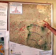 A map indicating the location of undocumented migrant deaths in the Arizona desert hangs in a church frequented by migrants in Altar, Sonora, Mexico.  The map was created by Humane Borders, a humanitarian organization in Tucson, Arizona, USA.