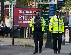© Licensed to London News Pictures. 11/10/2015. London, UK. Extra police on patrol near The scene outside the RE bar in Field End Road, Eastcote, Hillingdon where a man was stabbed to death early this morning (SUN). The victim is believed to be  21-year-old Josh Hanson from Kingsbury.  Photo credit: Ben Cawthra/LNP