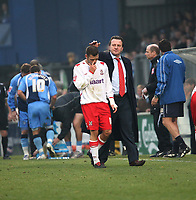 Photo: Karyn Haddon/Sportsbeat Images.<br />Wycombe Wanderers v Lincoln City. Coca Cola League 2. 17/11/2007.<br />Lincoln City's manager Peter Jackson (rt) consoles Ollie Ryan (lt) as he is sent off after receiving a red card.