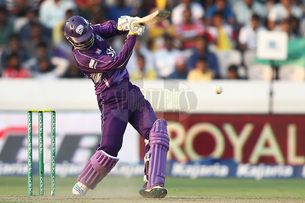 Shoaib Malik of the Hobart Hurricanes drives the final ball of the innings to the boundary during the first semi final match of the Oppo Champions League Twenty20 between the Kolkata Knight Riders and the Hobart Hurricanes held at the Rajiv Gandhi Cricket Stadium, Hyderabad, India on the 2nd October 2014<br /> <br /> Photo by:  Shaun Roy / Sportzpics/ CLT20<br /> <br /> <br /> Image use is subject to the terms and conditions as laid out by the BCCI/ CLT20.  The terms and conditions can be downloaded here:<br /> <br /> http://sportzpics.photoshelter.com/gallery/CLT20-Image-Terms-and-Conditions-2014/G0000IfNJn535VPU/C0000QhhKadWcjYs