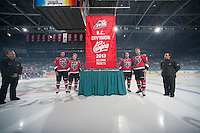 KELOWNA, CANADA - SEPTEMBER 21:  Madison Bowey #4, Zach Franko #9, Myles Bell #29 and MacKenzie Johnston #22 of the Kelowna Rockets raise the B.C. Division Champions banner during the regular season home opener at the Kelowna Rockets on September 21, 2013 at Prospera Place in Kelowna, British Columbia, Canada (Photo by Marissa Baecker/Shoot the Breeze) *** Local Caption ***