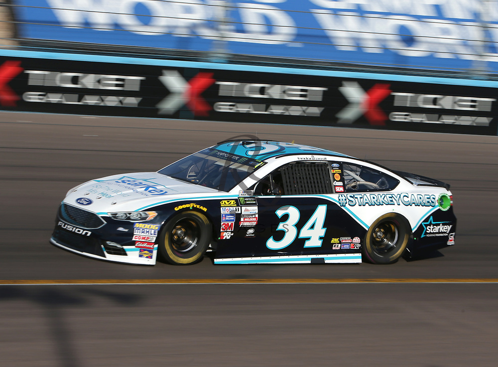 Landon Cassill qualifies for Sunday's NASCAR Cup Series auto race on Friday, March 17, 2017, in Avondale, Ariz.  (AP Photo/Rick Scuteri)