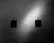 Sunlight beams onto a wll inside the church at Mission San Jose, San Antonio, Texas