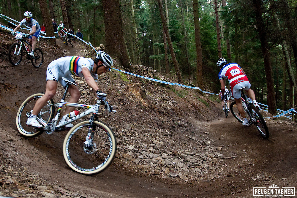 Nino Schurter of team Scott-Swisspower MTB-Racing chases Julien Absalon (No. 1) of team Orbea through the woods down to Medusa's Drop during the UCI Mountain Bike World Cup at Dalby Forest, North Yorkshire. SCHURTER went on to win, with a sprint finish and a time of 1:54:52.