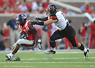 Mississippi running back Jaylen Walton (6) is tackled by Southeast Missouri State's Daniel Siehndel (15) at Vaught-Hemingway Stadium in Oxford, Miss. on Saturday, September 7, 2013. (AP Photo/Oxford Eagle, Bruce Newman)