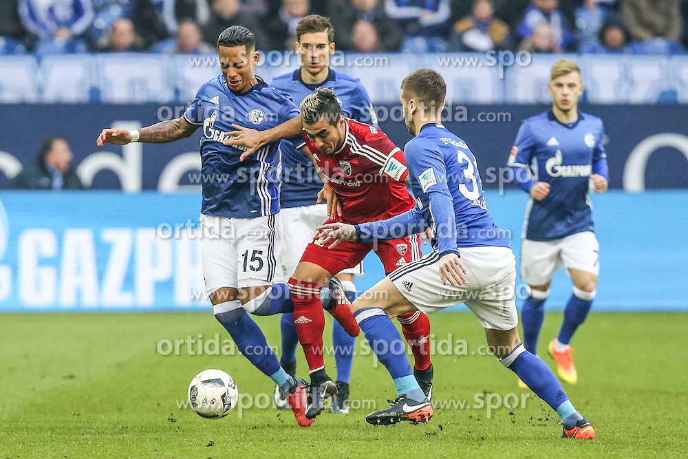 21.01.2017, Veltins Arena, Gelsenkirchen, GER, 1. FBL, Schalke 04 vs FC Ingolstadt 04, 17. Runde, im Bild Dario Lezcano (#11, FC Ingolstadt 04) zwischen Dennis Aogo (#15, FC Schalke 04) und Matija Nastasic (#31, FC Schalke 04) // during the German Bundesliga 17th round match between Schalke 04 and FC Ingolstadt 04 at the Veltins Arena in Gelsenkirchen, Germany on 2017/01/21. EXPA Pictures &copy; 2017, PhotoCredit: EXPA/ Eibner-Pressefoto/ Deutzmann<br /> <br /> *****ATTENTION - OUT of GER*****
