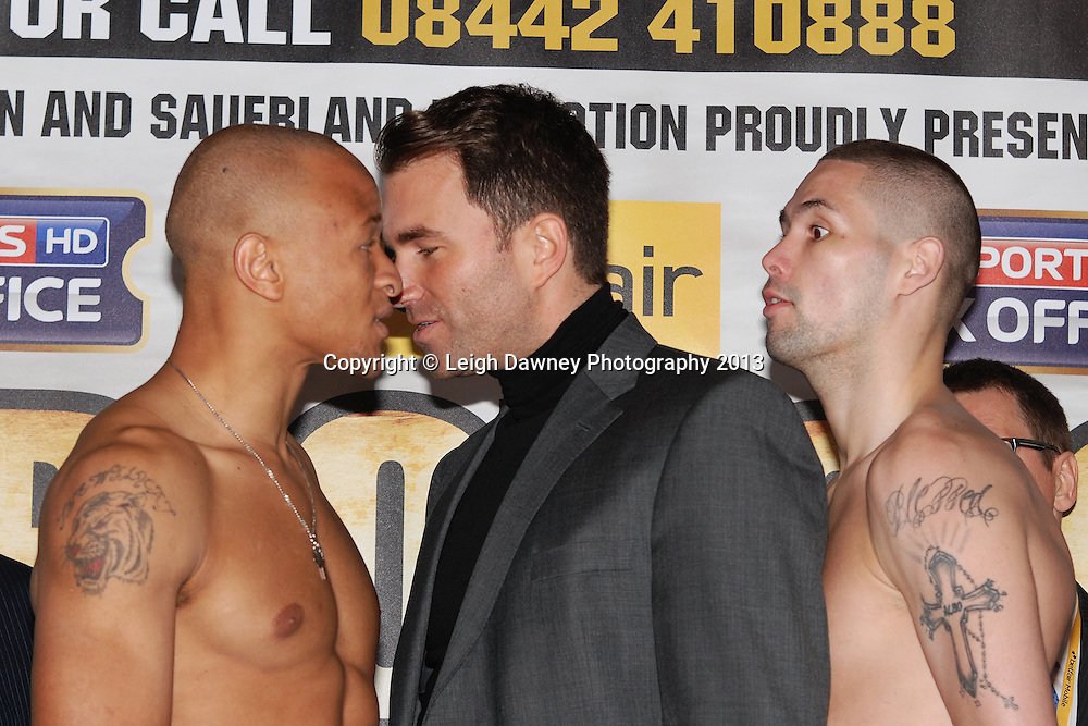Tony Bellew and Isaacs Chilemba exchange words as promoter Eddie Hearn intervenes at the Public Weigh In at London Piazza, 02 Arena, London, United Kingdom. 24.05.13. Credit © Leigh Dawney Photography 2013.