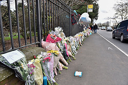 © Licensed to London News Pictures. 29/01/2018. London, UK.  Floral tributes have been laid out at the site of a car crash where three teenage boys were killed in Hayes, west London, on the night of 27 January.  Jaynesh Chudasama, 28, of Hayes has been charged with three counts of causing death by dangerous driving and will appear in custody at Uxbridge Magistrates Court on Monday 29 January.  Photo credit: Stephen Chung/LNP