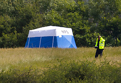 © Licensed to London News Pictures. 08/06/2020. London, UK. A police officer guards forensics tents at Fryent Country Park near Wembley, north London. According to reports, two women were found unresponsive and were pronounced dead at the scene yesterday. Photo credit: Peter Macdiarmid/LNP