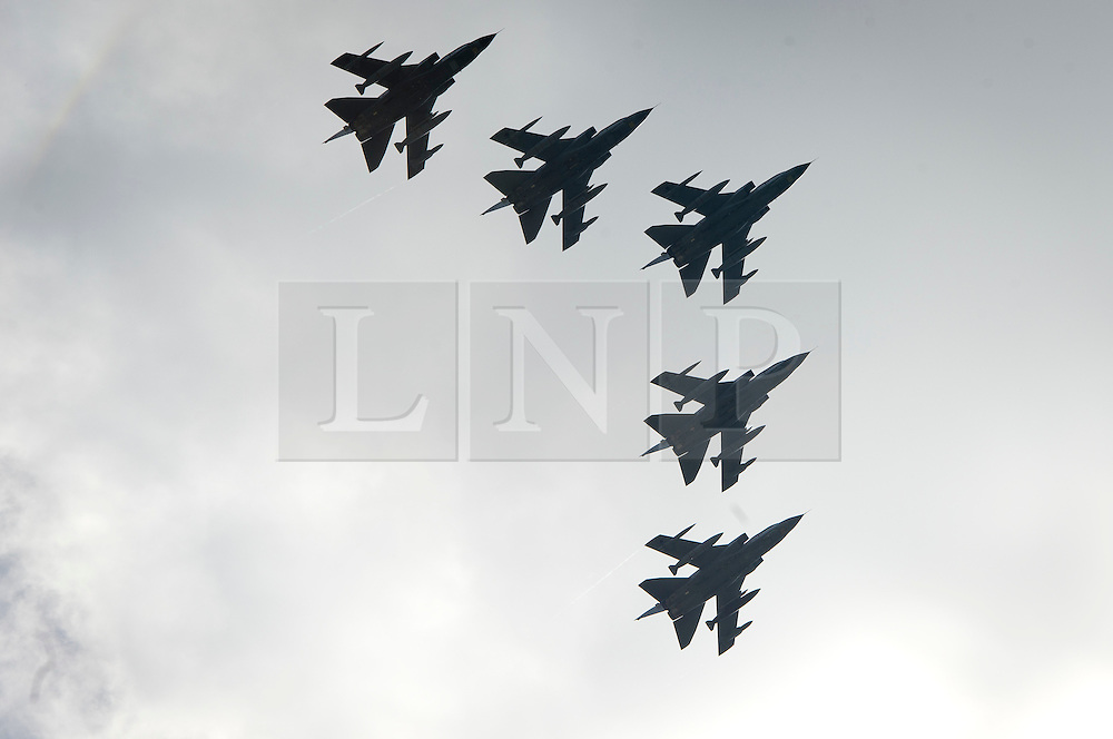 © London News Pictures. 28/06/2012.  London, UK. RAF Tornados performing a flypast during the unveiling of a new £3.5m Bomber Command Memorial in Green Park, London on June 28, 2012. The memorial which is dedicated to the 55,573 airmen who died in the Second World War is made of Portland Stone stands at over 8m tall with an open roof. The entrance is made from melted down aluminium sections of a Halifax bomber shot down during the war and in which all seven of the crew were killed. The memorial includes inscriptions from Winston Churchill. Photo credit: Ben Cawthra/LNP