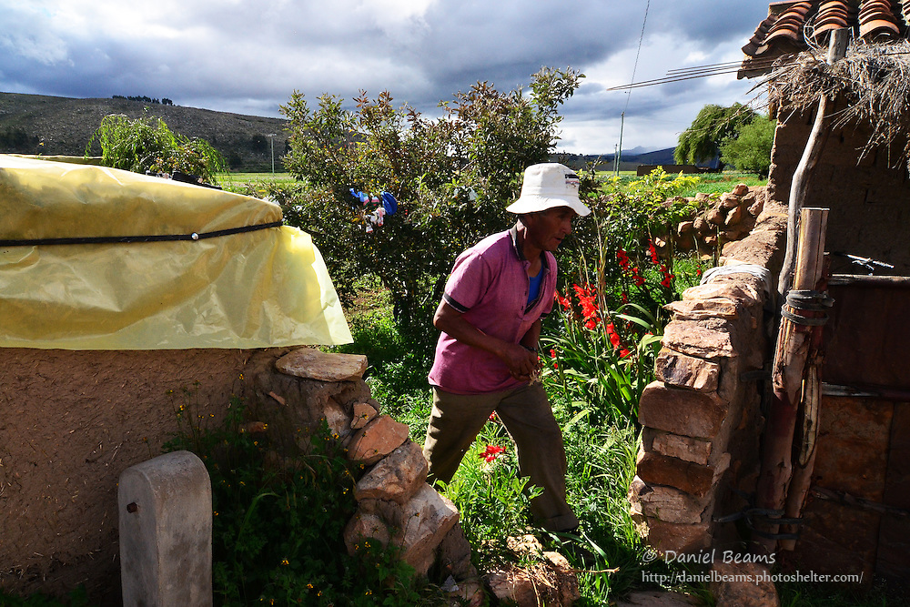 Quechua man in garden at 12,000 ft in the Andes, Cochabamba, Bolivia
