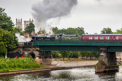 © Licensed to London News Pictures. 30/07/2020. York UK. Locomotive 45562 Alberta pulls the Scarborough Spa Express over the River Ouse in the shadow of York Minster in York this morning as the service resumes running today for the first time since the Covid-19 outbreak. Photo credit: Andrew McCaren/LNP