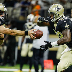 Aug 26, 2017; New Orleans, LA, USA; New Orleans Saints quarterback Drew Brees (9) hands off to running back Adrian Peterson (28) during warm ups before a preseason game against the Houston Texans at Mercedes-Benz Superdome. Mandatory Credit: Derick E. Hingle-USA TODAY Sports