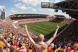 HOUSTON, TX - MAY 12: A fan cheers on the Houston Dynamo as the Dynamo play D.C. United in the first half of a MLS game at BBVA Compass Stadium on May 12, 2012 in Houston, Texas.  (Photo by Eric Christian Smith/Getty Images)