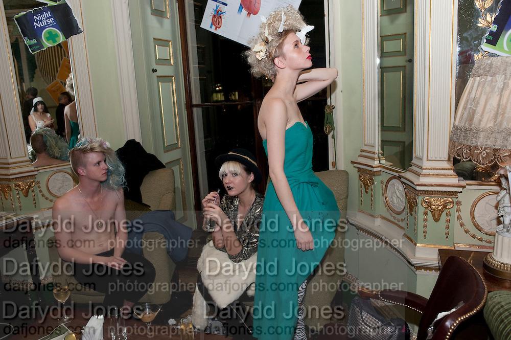 THOMAS EDWARD PETHERWICK; LAURA CHAMBERS; LAURA GREENWOOD; Philip Sallon's mass paranoia swine flu birthday party. Home House. Portman Sq. London. 13 November 2009.