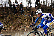 Belgium, March 31 2013: Laurens de Vreese from TOPSPORT VLAANDEREN-BALOISE on the Oude-Kwaremont climb during the Ronde van Vlaanderen 2013 men's race. Copyright 2013 Peter Horrell.