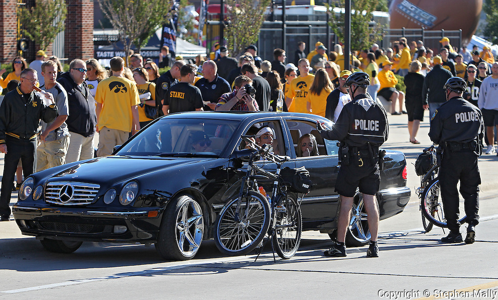 September 4 2010: A driver talks to two Iowa City Bike Police Officers after being pulled over outside Kinnick Stadium before the NCAA football game between the Eastern Illinois Panthers and the Iowa Hawkeyes at Kinnick Stadium in Iowa City, Iowa on Saturday September 4, 2010.