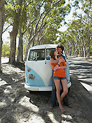 Couple Standing by Van