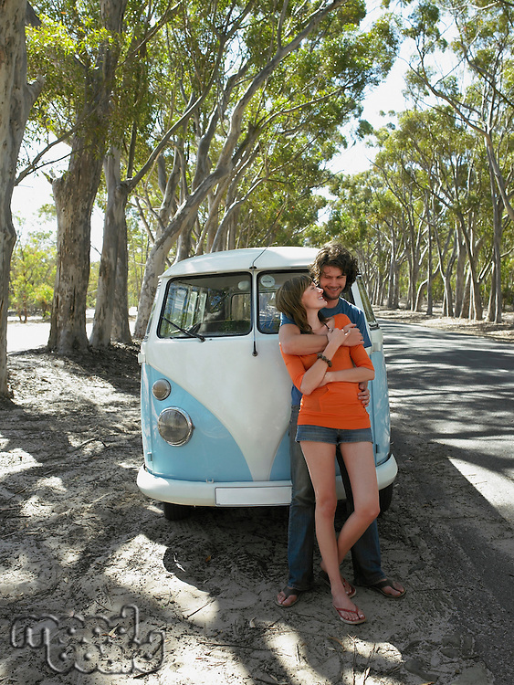 Couple Standing by Van
