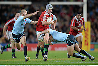 15 June 2013; Jonathan Davies, British & Irish Lions, is tackled by Bernard Foley, right, and Drew Mitchell, NSW Waratahs. British & Irish Lions Tour 2013, NSW Waratahs v British & Irish Lions, Allianz Stadium, Sydney, NSW, Australia. Picture credit: Stephen McCarthy / SPORTSFILE
