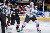 KELOWNA, CANADA -FEBRUARY 25: Dalton Yorke #5 of the Kelowna Rockets drops the gloves during first period with Aaron Macklin #11 of the Prince George Cougars on February 25, 2014 at Prospera Place in Kelowna, British Columbia, Canada.   (Photo by Marissa Baecker/Getty Images)  *** Local Caption *** Dalton Yorke; Aaron Macklin;