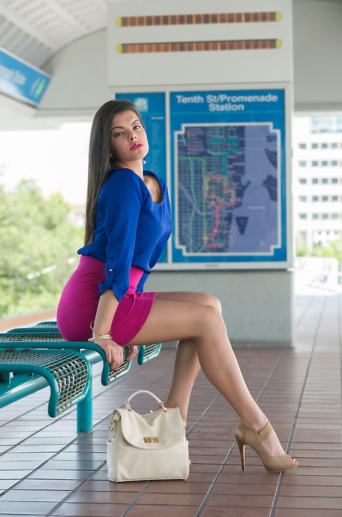 Young woman seated and waiting in a metro station platform