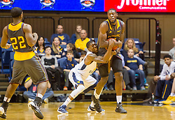 Nov 23, 2015; Morgantown, WV, USA; West Virginia Mountaineers guard Teyvon Myers creates a jump ball with Bethune-Cookman Wildcats forward Mario Moody during the first half  at WVU Coliseum. Mandatory Credit: Ben Queen-USA TODAY Sports